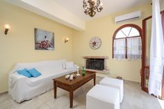 The living room with the fireplace and a comfortable sofa from which you can see the view of the villages. Shower Cabin, Comfortable Sofa, Living Room With Fireplace, Double Bedroom, Sitting Area, Beautiful Islands, Ground Floor, Beautiful Gardens, Gallery Wall