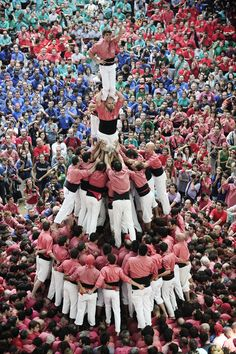 """In the city of Tarragona, Spain, castellers gather every two years to see who can build the highest, most intricate human castles. It requires astonishing strength, finesse, and balance. Not to mention courage"". //  Image by David Ramos / Getty Images  // http://www.youtube.com/watch?v=K1HWyUIZ5kk"