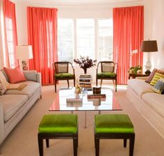 LIVING ROOM -- Beige furniture, coral curtains, coral accents. no green.