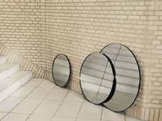 The AYTM Circus Wall Mirror is an elegant addition to any home. Its slim frame and tinted glass offer a dramatic visual effect, heightening its aesthetic appeal.