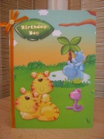 """This colourful and fun card measures A5 in size and comes with a white envelope and protected in a cello bag. The toppers feature various jungle animals and have been raised to give dimension. The sentiment reads """"Birthday Boy"""". An orange ribbon and Card Candi has been added to decorate. The inside has been left blank for your own personal message. http://www.makesellbuy.com/products/view/136299383477/handmade-birthday-card-boys-colourful-jungle"""