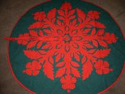 Hawaiian quilt style tree skirt. I can make it more snowflake like