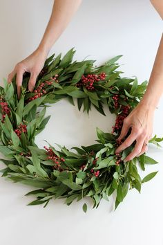make this gorgeous bay leaf and berry holiday wreath