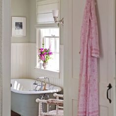 Claw foot tub with pink robe