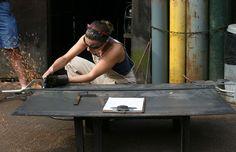 Karen (Rudy) Rudolph Cutting Steel Plate. Rudy was Resident Blacksmith 2002-2004. Blacksmith Shop, Thors Hammer, Forged Steel, Steel Plate, Metalworking, Blacksmithing, Singing, Folk, Songs