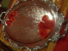 Tomato peel rose garnishes.