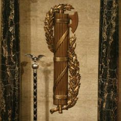 Roman Fasces symbol of strength in numbers with mace. Star Fort, Anubis Tattoo, Symbols Of Strength, Forts, Ancient Rome, Coat Of Arms, Weapon, Acoustic, Roman