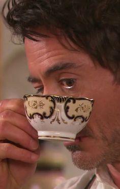 *wonders if Mrs. Hudson drugged the tea* Robert Downey Jr. and a cuppa tea. Two of my favorite things. Robert Downey Jr, Sherlock Holmes Robert Downey, Warner Bros Movies, Holmes Movie, Irene Adler, Guy Ritchie, Cuppa Tea, Downey Junior, Baker Street