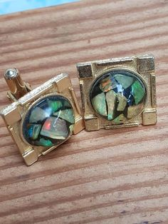 Check out this item in my Etsy shop https://www.etsy.com/au/listing/526778368/mid-century-opal-cufflinks-gold-tone