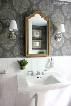 Bathroom makeover (such a huge change from the before!)   Stenciled walls   Pedestal sink   Sconces   Wood medicine cabinet