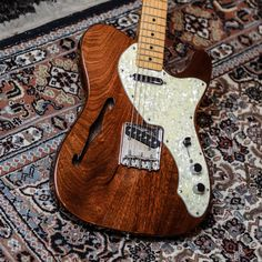 Factory Natural Wood Color Electric Guitar With Zebra Wood Veneer,white Pearl Pickguard,rosewood Fretboard,can Be Customized To Win A High Admiration And Is Widely Trusted At Home And Abroad. Sports & Entertainment
