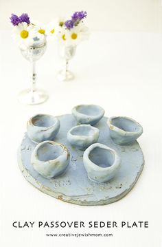Passover kid's craft clay seder plate, that you can also make as a last minute craft using air dry clay, or polymer clay for mini versions. make some polymer clay food to fill the cups and it will be adorable!