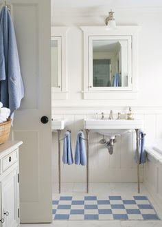 John Gould Bessler Photography  white & blue beachy boy's bathroom design with white ...