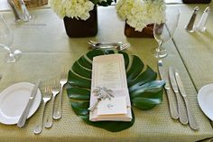 Palm fronds as place mats, hand cut!  Palm tree bottle opener for place card setting and #letterpressed menu card.  Photos by @Donna Von Bruening Photographers  and planning by Spencer Special Events