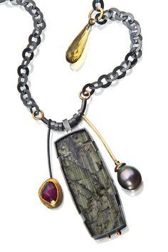Natural tourmaline surface combined with Tahitian pearl, rhodolite garnet, cognac quartz drop.
