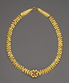 Roman necklace, circa 3rd century C.E. Gold, with amethyst stone. Currently at the Getty Villa Museum.