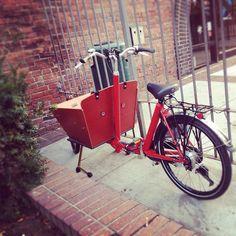"""Traditional Dutch cargo bike or """"bakfiets"""" parked in Somerville, MA."""