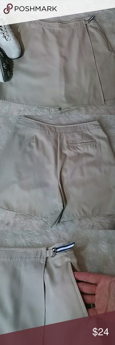 •Izod• Woman's Golf Shorts/ Skort• 12 Izod skort, new without tags khaki color zipper closure 100% Poly , wraps on front it navy and white buckle closure. Measurement Waist 16.5in Length. 17in •Tags• Summer, vacation, beach, picnic, wedding,shopping, Boating, summer night, anniversary, birthday, wedding, back to school, Labor Day, Memorial weekend, date night, summer pictures fall spring autumn winter summer, warm, cool, in style ,out on the town, professional, job, career, casual, jeans…