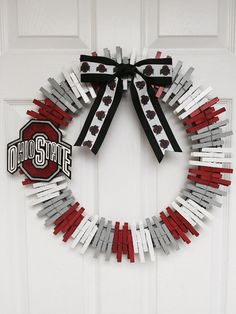 Handmade Ohio State Buckeyes wreath is made with care and love. Clothes pins make up the majority of the wreath. Each clothes pin is hand painted