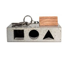 Never lose your keys again with the HAUS Key Tresor designed by Studio Ivanka. This concrete box goes on your wall and your keys attach to a shaped block that locks in place according to shape. ($58)    Read more: http://www.dwell.com/slideshows/dwell-holiday-gift-guide-for-the-person-who-has-everything.html?slide=5=y=true##ixzz2EP52IrRw