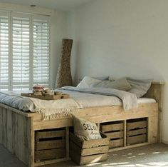 DIY ~ Pallett Bed with Storage Crates.. some extra sanding and white wash painting or chalkboard paint could make this very special! via http://www.bobvila.com/