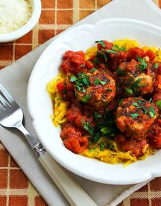Roasted Spaghetti Squash with Homemade Tomato-Garlic Sauce and Chicken Sausage Meatballs  found on KalynsKitchen.com