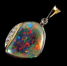 Unique Collectors Opal set in 18k with diamonds and gold chain  $3,500.00