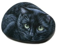 A Smouth Beach Stone is Hand-Painted and Transformed into a Black Kitty! Painted with Acrylics and finished with Glossy varnish protection.