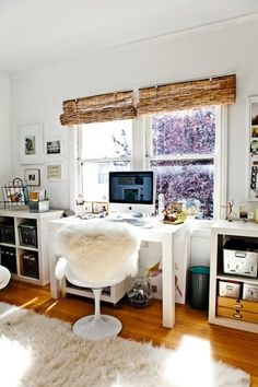 dens/libraries/offices - Expedit Shelving Unit West Elm Parsons Desk with Drawers Saarinen Tulip Chair bamboo roman shades vintage metal baskets flokati rug