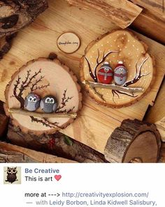 Painted stone birds on wood slices.