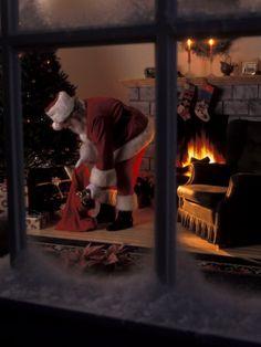 santa claus putting toys under the tree | Santa Claus...