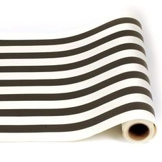 "This Classic Black & White Stripe Table Runner is the perfect backdrop for an elegant table setting, or gift wrap for any occasion. 20"" x 25' roll. Designed"