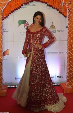 Bollywood actress Jacqueline Fernandez poses for photographers after arriving for the Char...