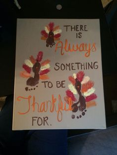 Thanksgiving canvas art with little ones footprints.