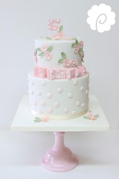 Ellas cake, I would take the bow off and use cut or plain crystal cake stand