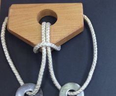 I made a run of these two ring puzzles about three years ago, and they were quite popular as gifts. The joy is, once you know the secret, you want to watch others labor over it. Turns out we're all sickos.... I drilled a 35mm hole in the face. The rope is just nylon rope from the home depot and some large steel washers I found in the shop. (As long as they are just too big to pass through the hole.) The closer they are the more infuriating for the puzzler solver and the more joy you get w...