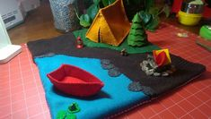 Camping Play mat. Waldorf Tag Sale: Made by Sarah Grogg from upcycled lambswool sweater and wool felt with cotton backing, and lavender sewn in. Set includes tent, campfire, rowboat, tree (stuffed with wool), and lantern. Approximately 14x14. More photos in comments.  $62ppd