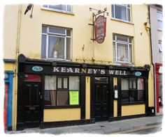 Kearneys Skibbereen - Click pub photo image above to purchase your #Pubs of #Ireland Photo Print with PayPal. You do not need a PayPal account to purchase photo. Pubs of Ireland photos are perfect to display in any sitting room, family room, or den to celebrate a family's Irish heritage. $9.00 (plus $5 shipping & handling in USA) ~ 8 x 10 High Quality, High Resolution Authentic Photos Professionally Shot on Location in Ireland and Printed on Professional Fuji Film Photo Print Paper.