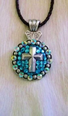 Western cowgirl  cross concho necklace accented with genuine glass crystals. $16.00  www.pamperedcowgirl.com