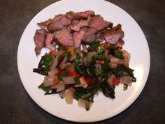 Marinated some beef chuck steak in a soy, garlic, dark rice vinegar mix.  Grilled quickly over hot coals.  Sliced thinly, served with beet greens.  The greens were braised with bacon, onion, garlic, some more onion and hot peppers.