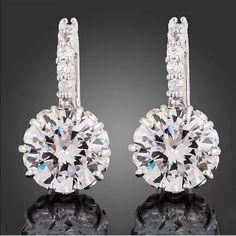 Elegant S925 Stamped white Swarovski hoopearrings New Elegant S925 Stamped white Swarovski hoop earrings. Size 1cm x 2.2cm Jewelry Earrings