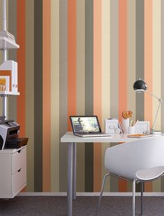 Orange, grey and tan striped wallpaper for wall along stairs.