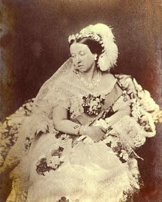 Queen Victoria, on the her wedding day to Prince Albert..Orange blossoms were very popular accessories during the Victorian era, often worn as a wreath or circlet, which is exactly what Queen Victoria wore on her wedding day. Her orange blossom crown was accented with two large ostrich feather plumes that helped fill out the space over her lace veiling. The plumes appear in the royal photographs, but were omitted in her bridal portrait.