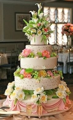Wedding Cake: Peach/pink swaths, mini bouquets of daisies and a burst of flowers at the cake top.  Gorgeous.