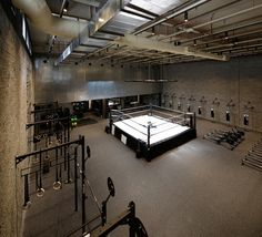 The materials employed were inspired by retro boxing gyms, which were used without any extensive decorations. Therefore, the materials used were a combination of concrete blocks, subway tiles, steel, and hints of natural wood. Curved glass corners were used to ensure a welcoming and clear route between the entrance, lockers, and main workout area