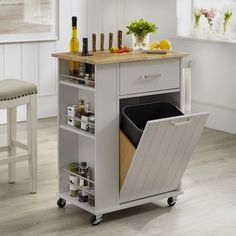Store all your kitchen essentials in this charming Lima Kitchen cart. Three side shelves and a drawer offer space for spices, cooking tools and more. Pull-out garbage compartment fits a small trash bin. Also features towel rack and casters for mobility. Crafted of sturdy MDF with a solid rubberwood top. Available in your choice of color ? Blush Pink, White and GreyIncludes one (1) kitchen cartOne (1) drawerThree (3) tiered spice rack and towel barRolling castors (two are locking)Beadbo..