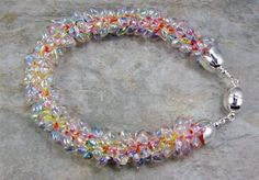 Rainbow kumihimo bracelet by Debbie Altman What's not to love about beaded kumihimo? It's fast, easy to learn, a great alternative to bead crochet for those of us who aren't inclined to use a hook, and it's as close to instant gratification as some of us beaders can hope for — a simple beaded kumihimo…