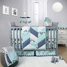 Stylish geometric prints in cool shades of blue adorn the contemporary Mosaic Crib Bedding Collection from The Peanut Shell. The 100% cotton Mosaic 3-Piece Crib Bedding Set includes a pieced herringbone quilt, fitted crib sheet, and a crib skirt.