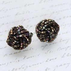Dark Black Multi-Tone Cluster Bead Clip Earrings, £8.00 by Queenies Bazaar:   Item: Earrings (Clip) Size: 2.5cm Condition: Good - Showing some wear to backs Designer or Brand: Unsigned  Description: Beautiful wearable vintage at affordable prices.  These lovely genuine vintage clip-on earrings feature dark black multi-tone glass beads in a cluster design.   Lightweight, easy to wear with strong and comfy clips. Measuring approximately 2.5cm wide. Gold plated backs. Unsigned - Possibly…