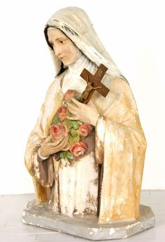 This turn of the century chalkware devotional bust, with its original paint surface, depicts Saint Therese of Lisieux